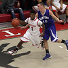 Salem guard Christian Dunston flies bye Danvers defender Jon Amico (10) on Tuesday night. David Le/Salem News