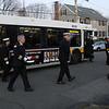 Peabody: Fire Chiefs from many towns and cities around Massachusetts get off an MBTA bus to pay their respects to fallen Peabody firefighter Jim Rice on Thursday night, David Le/Salem News