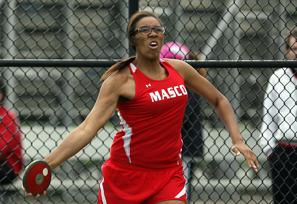 Masco senior Claire Dew unleashes a throw in the discus on Wednesday afternoon. David Le/Staff Photo