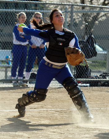 Danvers catcher Samantha DiBella fires to first to throw out a Swampscott baserunner after fielding a bunt.  David Le/Staff Photo