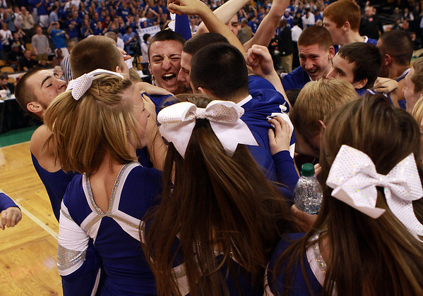 The Danvers High School boys basketball team and Danvers High Cheerleaders celebrate a 68-45 victory over Wareham on Monday afternoon at the TD Garden. With the win the Falcons advance to the D3 State Final at the DCU Center in Worcester on Saturday. David Le/Staff Photo