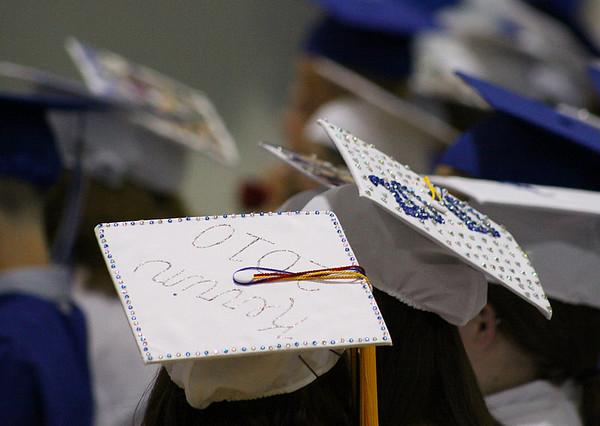 Danvers: Many of the Danvers High School Senior's sported colorfully decorated mortar boards at their graduation ceremonies held Saturday afternoon in the Danvers High Gymnasium. Photo by David Le/Salem News