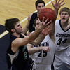 Endicott's Andre Makris (22) left, goes in for a layup against Gordon's David Dempsey (25). David Le/Salem News