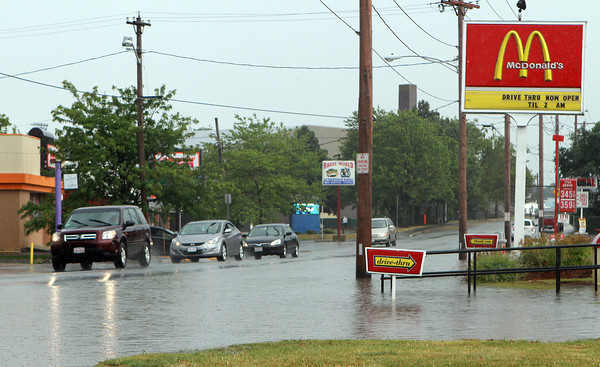 Traffic was slowed along Canal St. in Salem near the McDonald's as the street became partially flooded due to torrential rain on Wednesday afternoon. David Le/Staff Photo