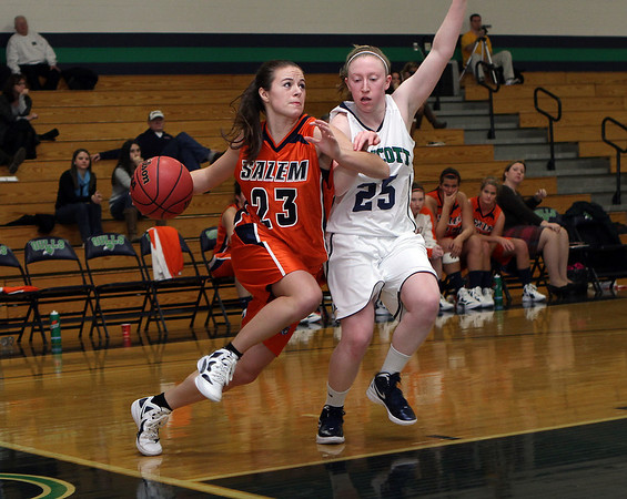 Salem State's Bridget Dullea (23) left, drives to the hoop while being defended by Endicott's Sarah Robinson (25)./ David Le/Salem News