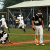 Bishop Fenwick pitcher Kevin Church walks past stunned teammate Gianni Esposito as the Lynnfield baseball team runs to mob teammate Craig Anderson after he singled in the game tying and winning runs on Thursday afternoon. Lynnfield scored 5 runs in the bottom of the 7th inning to comeback and defeat the Crusaders at Alumni Field in Lowell. David Le/Staff Photo
