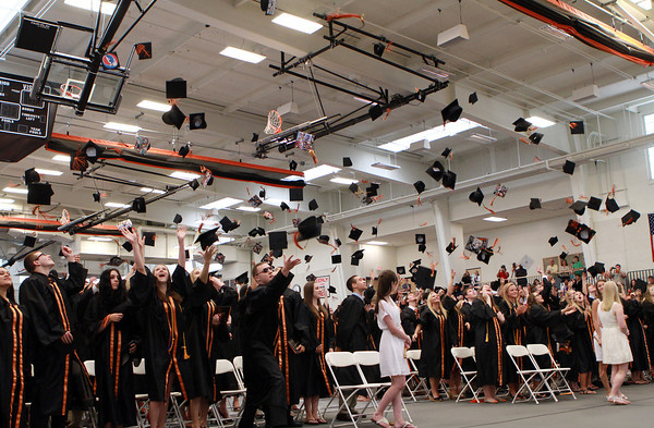 The Beverly High School Class of 2012 toss their hats high in the air at the end of their graduation ceremony on Sunday afternoon. David Le/Staff Photo