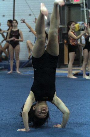 Yellowjackets gymnast Stephanie Li does a back flip at practice. David Le/Staff Photo.