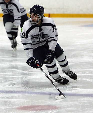 St. John's Prep junior Cam Shaheen (10) carries the puck up ice. David Le/Staff Photo