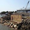 Constructions workers are building a new seawall behind the Salem Ferry Terminal. David Le/Staff Photo