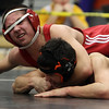 Masco's Nick Rizza, top, checks the clock quickly while grappling with Greater Lawrence Tech's Fred Tavarez. David Le/Salem News