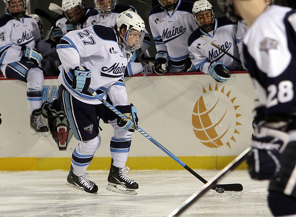UMaine captain and Salem native Will O'Neill flies up ice carrying the puck. David Le/Salem News