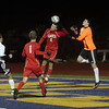 This header by Masco foward Charles Sherman (6) beat Ludlow keeper Nicholas Zucco for Masco's lone goal of the game. David Le/Salem News
