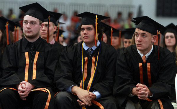Beverly High School graduates Nick Krukonis, Nick Koenig, and Ryan Knight, listen to class co-valedictorian Erin Silvestri as she delivers her remarks on Sunday afternoon. David Le/Staff Photo