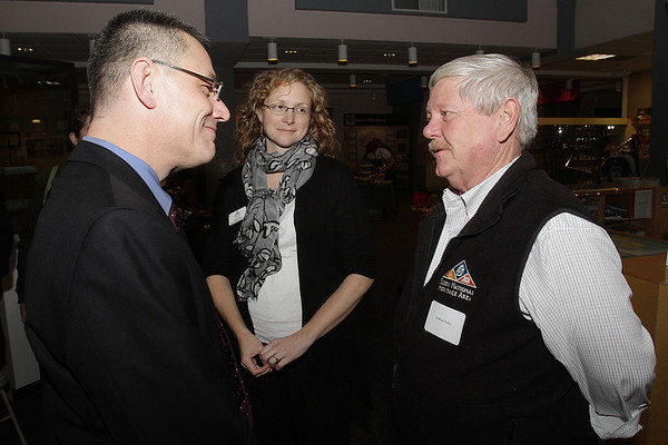 Salem: Newly appointed Superintendent of the Salem Maritime National Historic Site, Michael Quijano-West, left, talks with Elizabeth Rankin, of the Essex National Heritage Commission, and William Pickles, Trustee Emeritus of the Essex National Heritage Area. David Le/Salem News