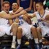 Danvers junior Duncan D'Hemecourt, left, senior Paul Nicolo, center, and junior Evan Eldridge, right, start the celebration as the clock ticks down to zero, giving the Falcons' their first D3 Basketball State Championship. David Le/Staff Photo