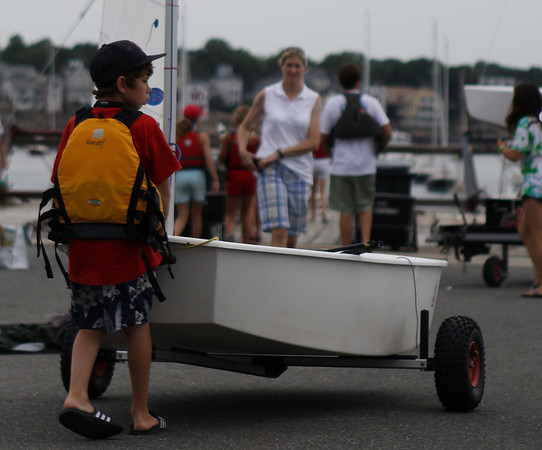 Marblehead: Jack Garvey, 11 of Marblehead, steers his sailboat towards the dock and prepares himself for his race. The Pleon Yacht Club in Marblehead plays host for Marblehead Junior Race Week which kicked off on Monday afternoon. Photo by David Le/Salem News