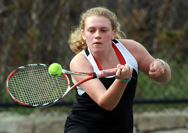 Marblehead second singles player Mary-Lindsay Ryan concentrates on returning a volley against Salem on Monday afternoon.David Le/Staff Photo