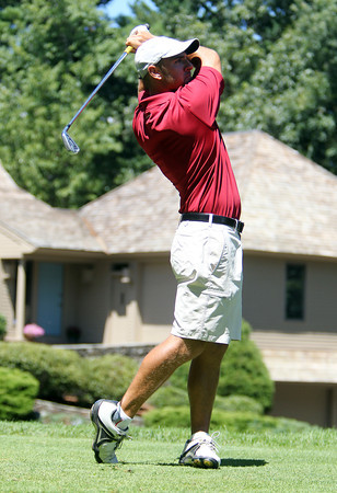 Matt Michel, of Danvers, keeps his eyes on his drive off the tee at the 15th Hole during the Ouimet Memorial Tournament on Wednesday afternoon. David Le/Staff Photo