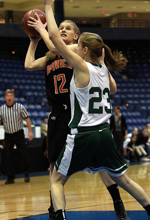 Ipswich freshman Caroline Soucy (12) left, goes up for a shot against Pentucket's McKenna Kilan (23) right. David Le/Staff Photo