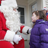 Julia Forte, 3 1/2, of Beverly, smiles up at Santa Claus when he visited Danvers on Saturday afternoon. David Le/Salem News