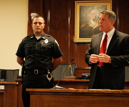 Beverly: Beverly Police Officer William Barror is praised and acknowledged by Beverly Police Chief Mark Gray for Barror's brave actions during an apartment fire on Mill Street on the 4th of July, in a ceremony held at Beverly City Hall on Tuesday evening. Photo by David Le/Salem News