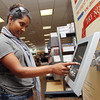 Incoming Salem State freshman Bharti Parris, 19, of Gloucester, tries out a new electronic textbook in the Salem State University Bookstore on Thursday afternoon. David Le/Staff Photo