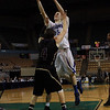 Danvers junior Nick Bates (15) right, goes for a layup against St. Joseph's Jon Bianchi (4) left, on Saturday afternoon at the DCU Center in Worcester for the D3 State Championship. David Le/Staff Photo