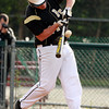 Bishop Fenwick Brian Burke manages to muscle a base hit into left field against Lynnfield on Thursday afternoon. David Le/Staff Photo