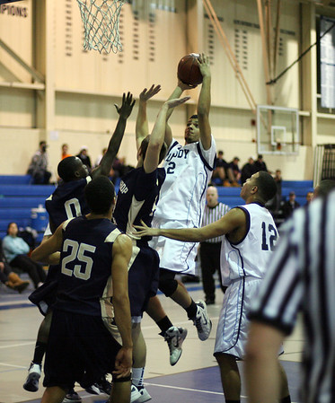 Peabody's Yardley Taveras (22) center, rises up over the Winthrop defense and sinks a shot. David Le/Salem News