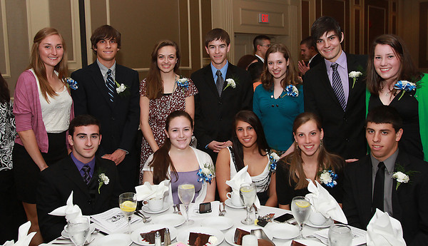 Clockwise from back left, Danvers High School seniors Katie McKenna, Brian Menezes, Kallie Dieter, Jim Grace, Sarah Vandewalle, Jeramy Evans, Emily Hodgkins, Ethan Collins, Allison Houde, Alex Cordoba, Emily Moore, and Eric Correia, at the 44th Annual Honor Scholars Recognition Dinner at CoCo Key Hotel in Danvers on Tuesday evening. David Le/Staff Photo