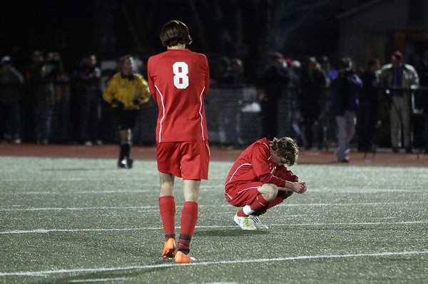 Masco junior Michael Ennis (8) slowly walks over to senior captain Alex Brown (3) following a loss to Ludlow in the D I State Championship on Friday. David Le/Salem News