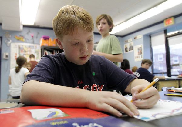 Logan Hood, a 5th grade student at the Marblehead Community Charter Public School works on an art project in preparation for their Monday night Exhibition. David Le/Salem News