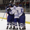 Salem: Danvers High School players mob Tyler Dustin after he scored a first period goal to put the Falcons up 1-0 over Winthrop. David Le/Salem News