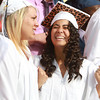 "Peabody High School seniors Cassandra Grzybinski, left, and Paula Feris, right, sing with emotion as they perform ""I'll Be There For You"" during Graduation on Friday evening. David Le/Staff Photo"