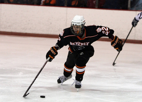 Beverly's Connor Irving carries the puck up ice against Peabody on Monday afternoon/ David Le/Staff Photo