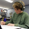 Marblehead Community Charter Public School 6th grader Aidan Collins, writes down notes for a piece of music he was creating on Wednesday afternoon. David Le/Salem News