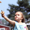Elizabeth Swanson, 6, of Salem plays ring catch at the House of 7 Gables on Thursday afternoon during the Salem Heritage Days festivities. David Le/Staff Photo