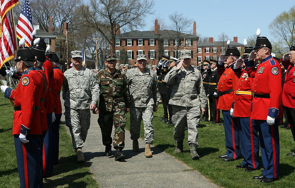 Major General L. Scott Rice, Interim Commander of the Massachusetts National Guard, right, salutes as he passes a regiment during a pass and review ceremony, along with Lt. Colonel Sterling MacLeod, left, Lieutenant General Jorge Ramirez, of Paraguay, second from left, and Lt. Colonel Brant Bersani, second from right. David Le/Staff Photo