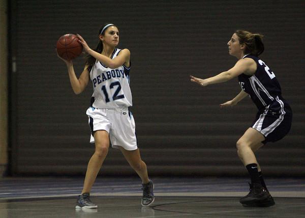 Peabody's Alexandra Lomasney (12) looks to pass against Swampscott on Friday. David Le/Salem News