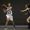 Peabody's Alexandra Lomasney (12) looks to pass against Swampscott on Friday. David Le/Salem News