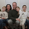 Marblehead: Sargeant Paul Atkinson, of Marblehead, center, sits with his family, from left, Everest Tilkens, 6, wife Maria Tilkens-Atkinson, Remington Tilkens, 6, and Bailey Atkinson, 11, in their home. Atkinson returned from duty in Afghanistan on December 23rd, a nice holiday suprise for his children. David Le/Salem News