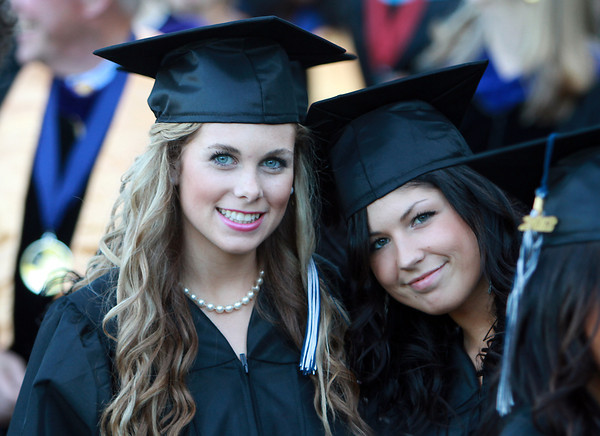 North Shore Community College Graduates Paige Hardway, left, of Merrimac, and Peyton Morris, right, of Boxford, pose for a photo before entering the O'Keefe Center at Salem State University for their graduation commencement on Thursday evening. David Le/Staff Photo<br /> , North Shore Community College Graduates Paige Hardway, left, of Merrimac, and Peyton Morris, right, of Boxford, pose for a photo before entering the O'Keefe Center at Salem State University for their graduation commencement on Thursday evening. David Le/Staff Photo