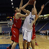 Danvers senior captain George Merry (32) center, looks to shoot while being double teamed by Saugus defenders during the D3 North Final at the Tsongas Center in Lowell, David Le/Staff Photo