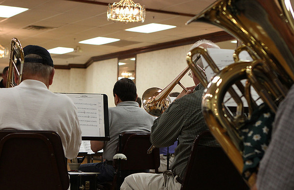 Salem: Members of the North Shore Concert Band rehearse at the Knights of Columbus music hall in Salem on Tuesday night. The local concert band will begin a series of free family concerts beginning June 29th at the Salem Willows. Photo by David Le/Salem News