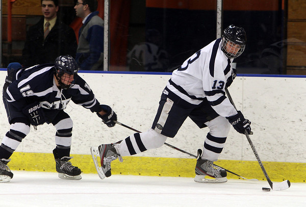 Peabody's Guiseppe Zarro (13) gets hasseled by St. John's Prep forward Jack McCarthy (19). David Le/Salem News