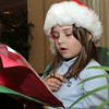 Peabody. Luci Dugan, a 4th grader from St. John the Baptist School in Peabody and a Girl Scout member, sings Christmas carol for a large audience at Brooksby Village on Tuesday afternoon. David Le/Salem News