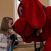 Lucy Luster, 2, of Salem, kisses Clifford the Big Red Dog at Old Town Hall in Salem during Salem's So Sweet Festival on Saturday afternoon. David Le/Salem News