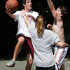 Jimmy Towey, 20, of Salem, left, goes up for a hook shot during pickup basketball while being defended by Anthony Cappelluzzi, 20, of Salem, and Elise Giangregorio, 20, of Swampscott, at Forest River Park. David Le/Staff Photo