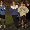 Danvers High School seniors Brian Hebert, left, Anthony Panciocco, center, and Javier Medina, right, lead the destance team in a warm-up on Thursday afternoon. David Le/Salem News